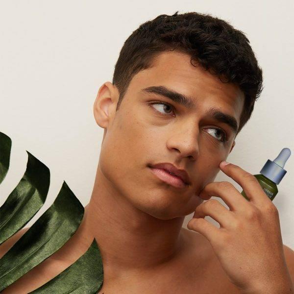 Brandon Holding Herban Wisdom Facial Oil Bottle