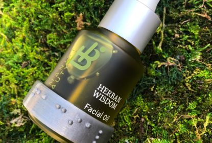 Herban Wisdom Facial Oil Braille ID Band Shown on Bottle