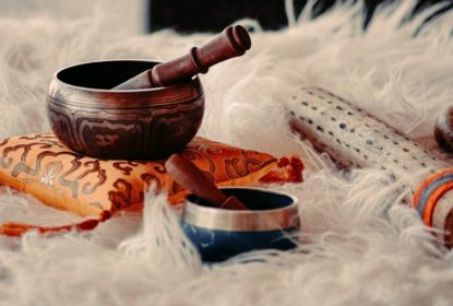 Tibetan singing bowls resting on a sheepskin rug