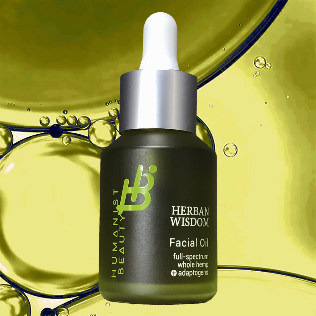 Herban Wisdom Facial Oil 1 ounce Against Oil Droplet Background