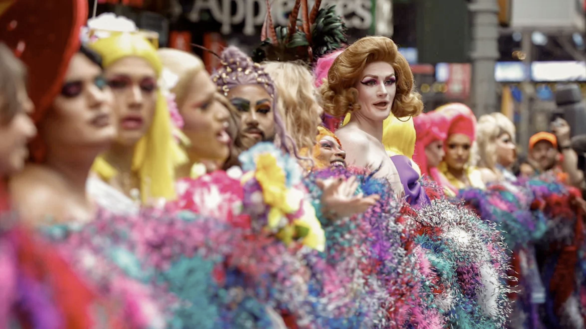 A shot of Pride Parade-goers in colorful costumes